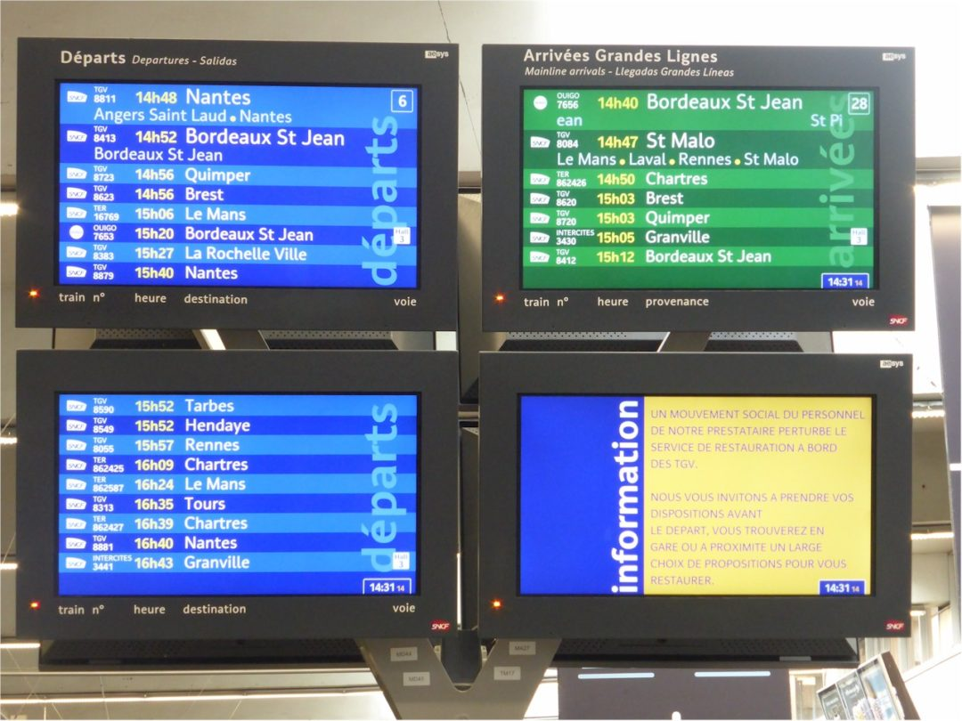Departure and arrival info-screens at Montparnasse, Paris, train station